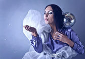 Beautifull woman stylised club fairy blowing off from palm silve — Stock Photo