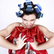 Emotional Girl with hair-curlers on her head - Stock Photo