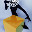 Сircus fashion mime posing near a yellow square - Stock Photo