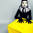 Сircus fashion mime posing near a yellow square — Stockfoto