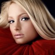 Attractive blond beauty in a red theatrical jabot — Stock Photo