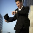 Checking the time. Worried young businessman — Stock Photo