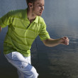 Cheerful guy in a green vest. — Stock Photo