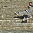 Young attractive man dancing in urban background - Foto de Stock