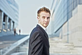 Handsome young businessman wearing suit — Stock Photo