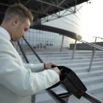 Business man holding elegant black leather briefcase. — Stock Photo