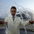 Businessman at fountain — Stock Photo