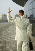 Stressed businessman gone away — Stock Photo