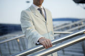 Hand of man in a classic suit keeps for a handrail — Stock Photo