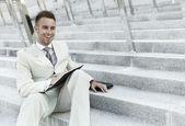 Businessman portrait with laptop — Stock Photo