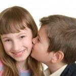 Boy kisses the girl on cheek — Stock Photo #2856588