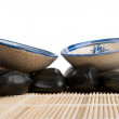 Royalty-Free Stock Photo: Two cups and stones on mat