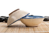 Two tea clay cups and stones on mat — Stock Photo