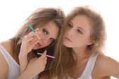 Two young women with cigarettes — Stock Photo