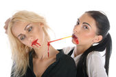 Woman sucks blood from neck of other woman — Stock Photo