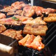 Tasty meal with fresh meat on grill — Stockfoto