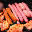 Tasty meal with fresh meat on grill — Stock Photo