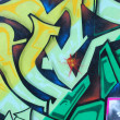 Segment of a colorful graffiti on a wall — Stockfoto