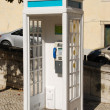 White portuguese telephone booth in Lisbon — Stockfoto
