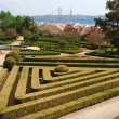Enchanted Ajuda garden with April 25th bridge in Lisbon, Portugal — Stock Photo