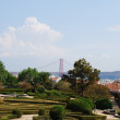 Enchanted Ajuda garden with April 25th bridge in Lisbon, Portugal - Stockfoto