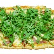 3-cheese pizza with prosciutto and arugula (isolated) - Stock Photo