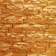 Unshaped stone wall (illuminated) - Stock Photo