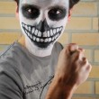 Portrait of a creepy skeleton guy (Carnival face painting) - Stock Photo