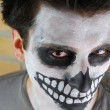 Royalty-Free Stock Photo: Portrait of a creepy skeleton guy (Carnival face painting)
