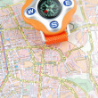 Travel concept with a compass on a map - Stock Photo