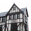 Black and white tudor house (isolated) - Stock Photo