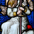 Religious stained glass window - Stock Photo