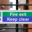 Fire exit sign — Stockfoto