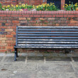 Sidewalk bench — Stock Photo