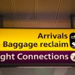 Informational signs at the airport - Stock Photo