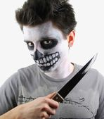 Murderer skeleton guy with a bloody knife — Stock Photo