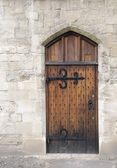 Wooden door from medieval era — Stock Photo