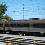 šedé vlak kolem místní vesnice — Stock fotografie #3910534