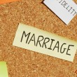 Stock Photo: Marriage keywords on a colorful cork board