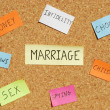Foto Stock: Marriage keywords on colorful cork board