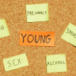 Young concerns on a cork board - Stock Photo