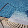 Swimming pool stairs - Stock Photo