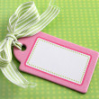 Blank pink tag on green - Stock Photo