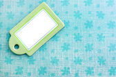 Blank green tag on blue — Stock Photo