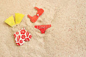 Bathing suits on the beach — Stock Photo