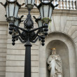 Statue and streetlight — Stock Photo