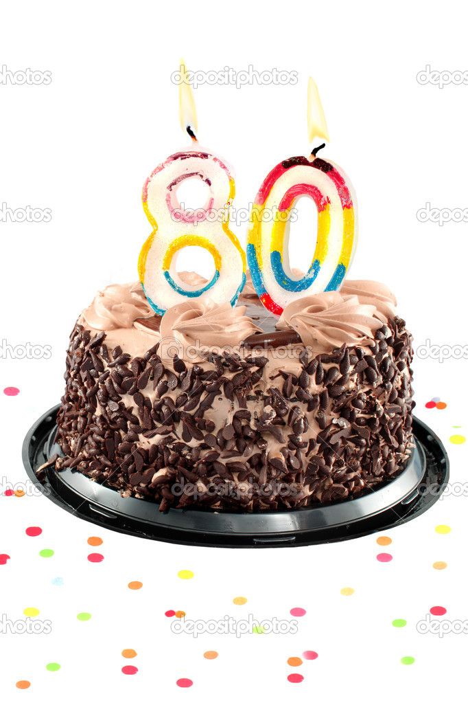 Chocolate birthday cake surrounded by confetti with lit candle for a eightieth birthday or anniversary celebration — Stock Photo #3186705