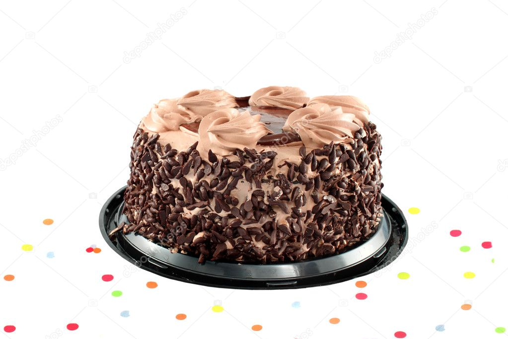 Fancy chocolate cake surrounded by confetti ready for a party isolated on a white background — Stock Photo #3521297