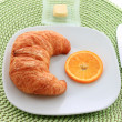 Golden croissant for breakfast - ストック写真