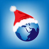 Santa hat on globe — Stock Photo